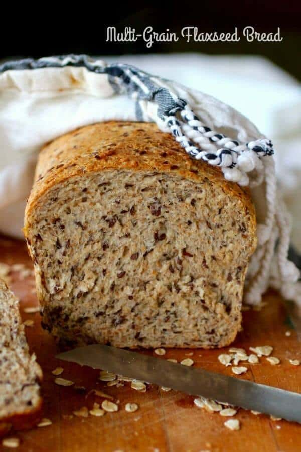 Here\'s a hearty, homemade multi-grain flaxseed bread recipe that\'s full of  healthy ingredients and a generous splash of honey to give it just enough sweetness. From RestlessChipotle.com #homemadebread #yeastbread #healthybreadrecipe #wholegrainbread