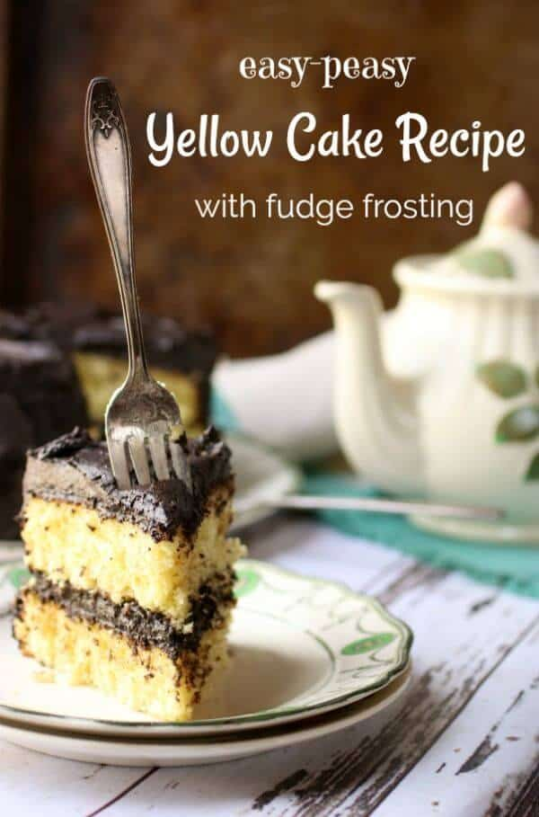 Title image for yellow cake recipe shows a slice of yellow layer cake with fudge filling and frosting on a plate. a sliver fork is thrust into the cake. An antique teapot is in the background.