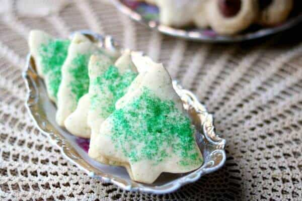 Sugar cookie Christmas trees with green sugar crystals made from the best rolled sugar cookie recipe ever!