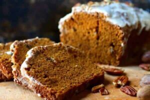 loaf of pumpkin spice bread with bourbon glaze