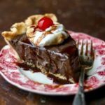 slice of chocolate pie with a cherry on top optimized for the recipe card