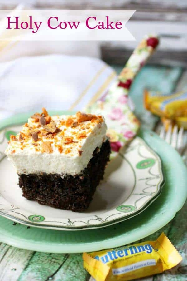 a square of chocolate holy cow cake with a thick layer of whipped cream frosting topped with butterfinger candy bars- title image