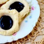 Easy Earl Grey Chocolate Thumbprint Cookies are old fashioned yumminess. From RestlessChipotle.com