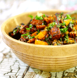 Closeup of roasted sweet potato salad in a vintage bowl - recipe illustration