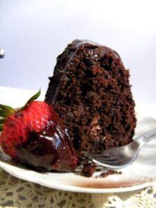a slice of chocolate cake on a cake plate