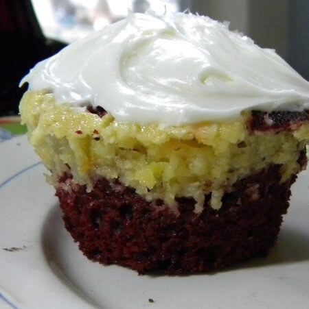 red velvet cupcakes marbled with orange cheesecake
