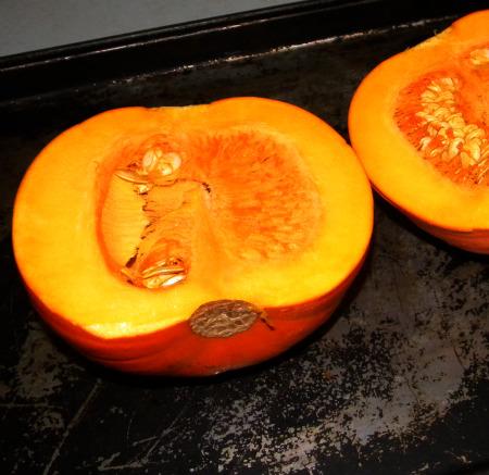 raw pumpkin cut in half
