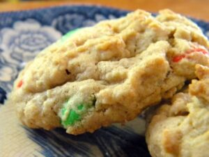 Big cookies with m&m candies on a plate.