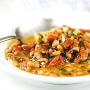 Closeup of a bowl of black eyed pea soup.
