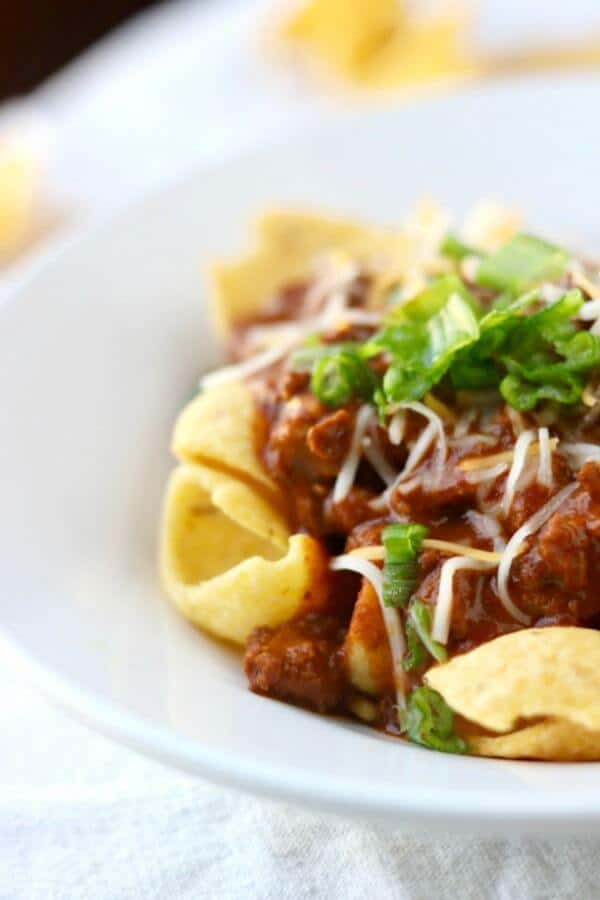 Frito pie is a classic Texas recipe that's found at nearly every high football concession stand as well as in many high end restaurants. It's quick and easy, has many variations, and is addictively good. This is the original Frito Pie recipe. From RestlessChipotle.com