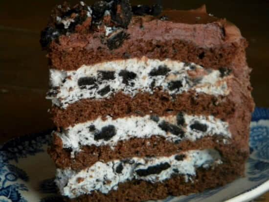of rich, moist chocolate cake with three layers of thick filling ...