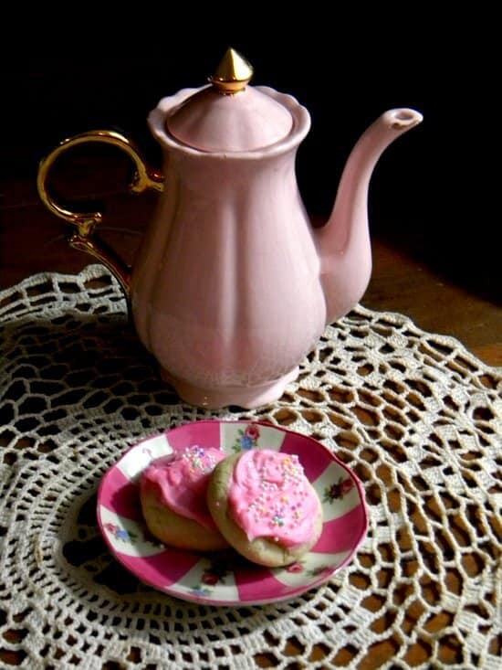 Cakey, soft Lofthouse sugar cookies recipe has a swirl of pink buttercream and sprinkles on the top. From RestlessChipotle.com