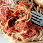 Closeup of chicken cacciatore over spaghetti