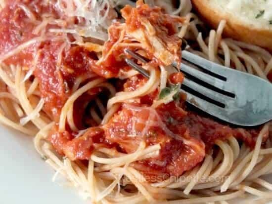 closeup of chicken cacciatore over spaghetti.