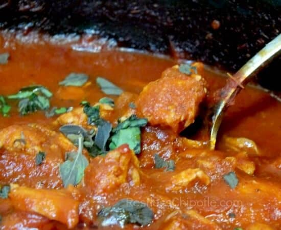 chicken cacciatore cooking in the pan