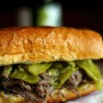 Slow cooked Italian beef sandwich with peppers on a plate