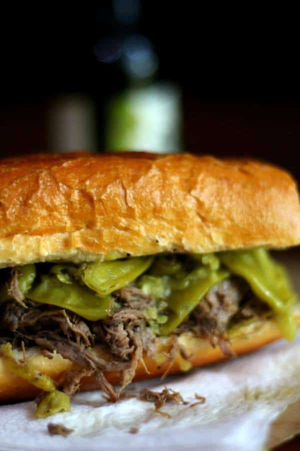 Easy slow cooker Italian beef sandwiches recipe is just right for game day! From RestlessChipotle.com