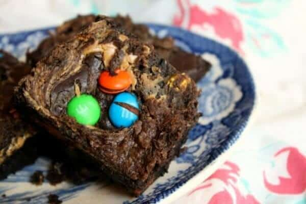 M&M brownies on a blue plate.