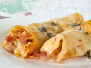 authentic chicken enchiladas in a creamy homemade sauce|restlesschipotle.com
