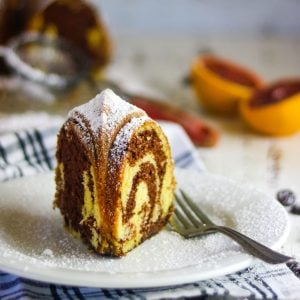 A closeup of a slice of marble pound cake.