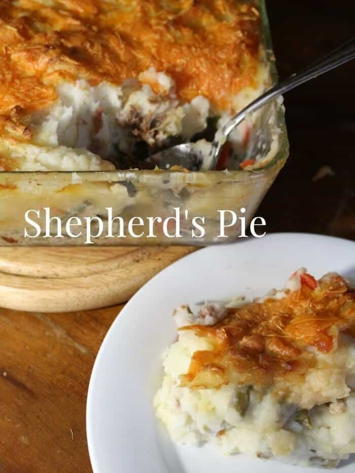 Shepherd's pie being served onto a white plate.