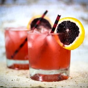 close up of red cocktails in short glasses.