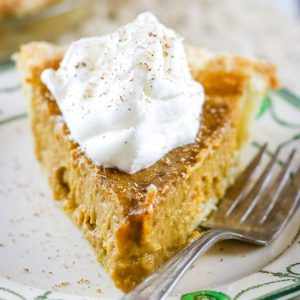 slice of butternut squash pie with whipped cream