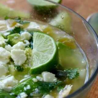 This quick and easy slow cooker pozole verde is one of our favorite meals. From RestlessChipotle.com
