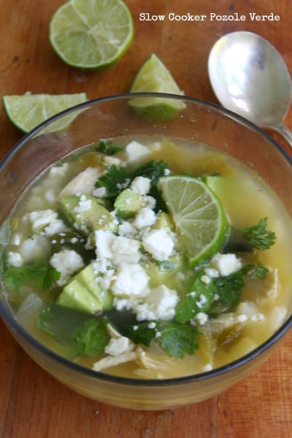 Easy slow cooker pozole verde is full of southwestern flavor and it takes no time at all to put together. From RestlessChipotle.com