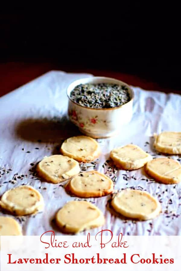 Baked lavender shortbread cookies on a piece of parchment.
