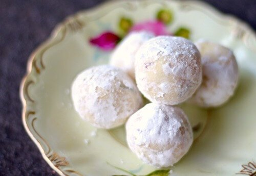 A vintage plate with roses on it holds lavender white chocolate truffles - easter dessert ideas