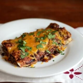 Super easy beef enchiladas - best of all you can make them ahead or freeze them! From RestlessChipotle.com