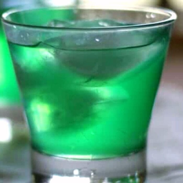 Bright green cocktail in a clear glass.