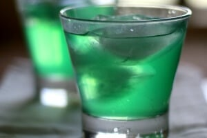 Hammered Hulk cocktail is a gorgeous green color with a tropical punch flavor. From RestlessCHipotle.com