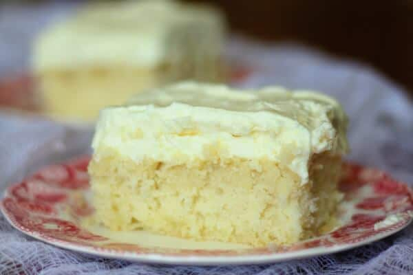 A square of lemon cream cake with fluffly lemon frosting - Easter dessert ideas