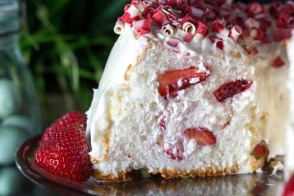 strawberry and cream filled angel food cake slice is one of many perfect easter dessert ideas