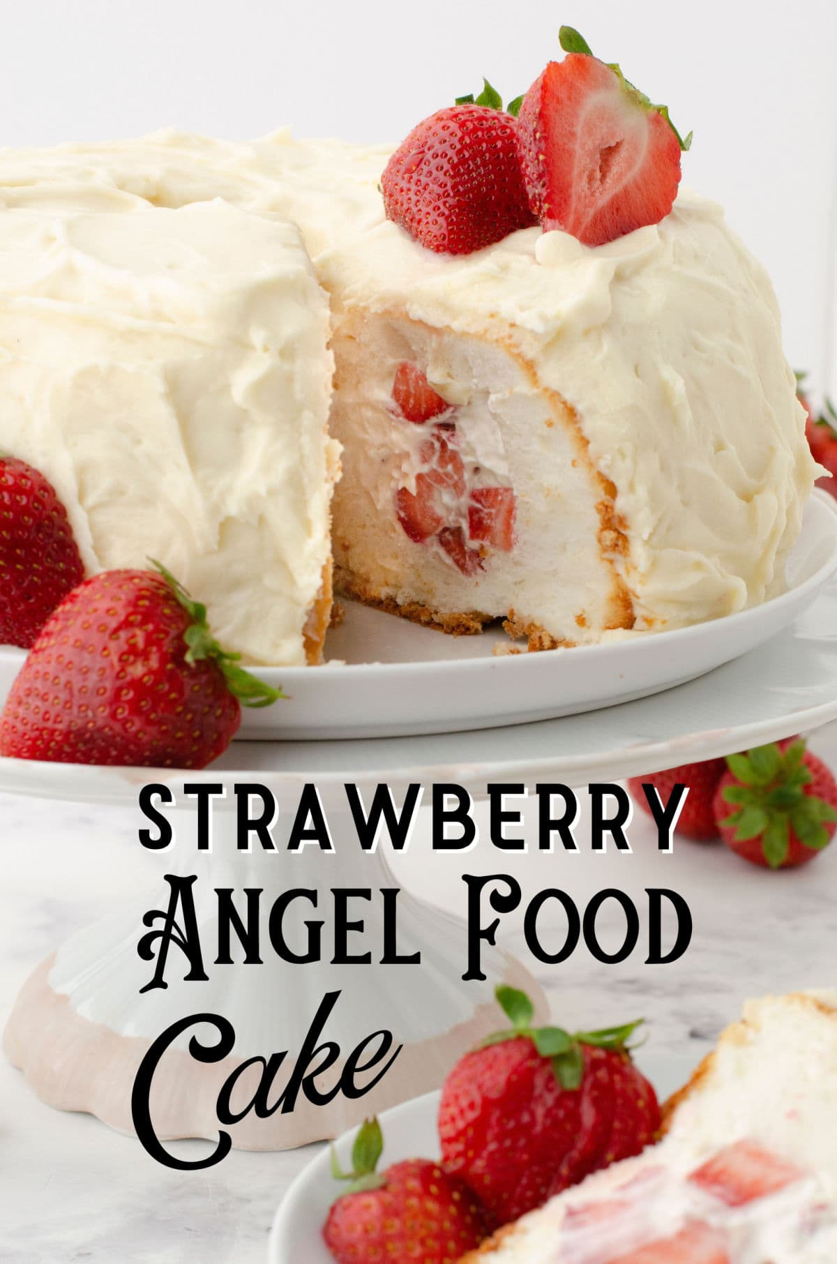 A cake on a plate with a serving removed to show the strawberry and cream filling.