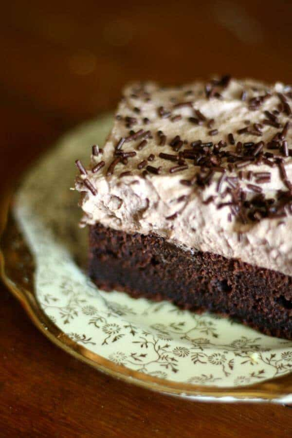 This old fashioned chocolate sheet cake has a creamy, light frosting. From RestlessChipotle.com