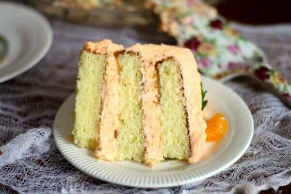 Slab of layer cake with thick filling and frosting.