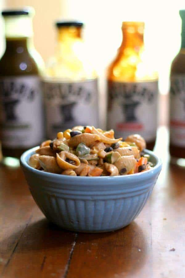 BBQ macaroni salad in serving bowl with Stubbs Sauces