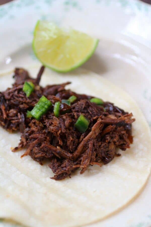Slow Cooked shredded beef is tender and juicy with lots of flavor. From RestlessChipotle.com