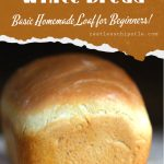 Loaf of baked bread with text overlay for Pinterest