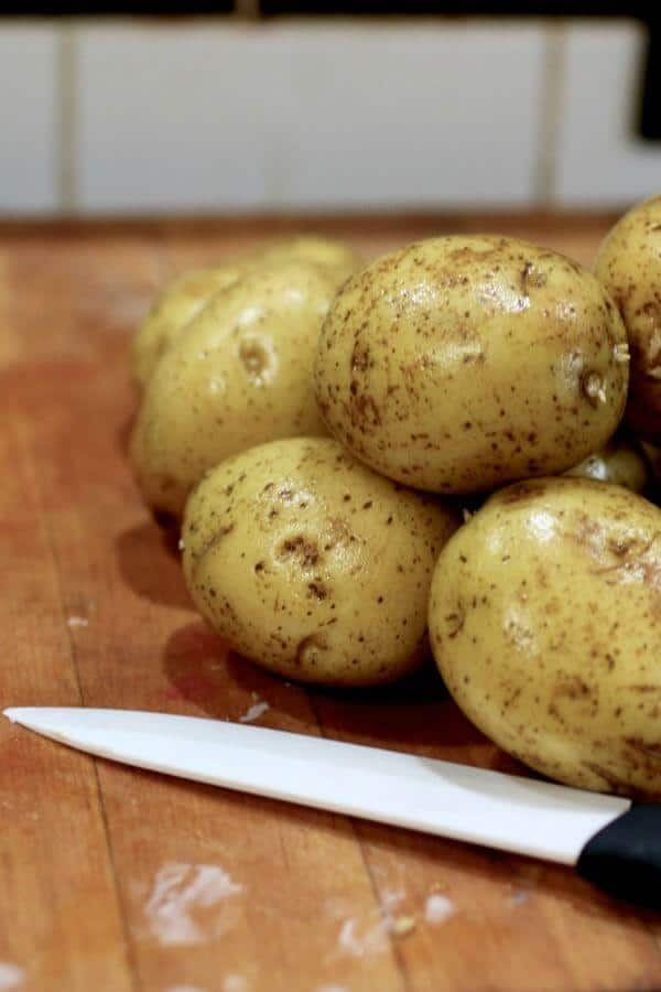 Raw potatoes are washed and ready to slice.