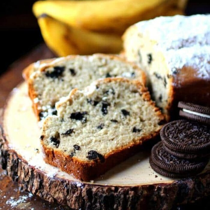 Slices of cookies and cream banana bread on a serving board.