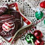 You've gotta try these yummy red velvet Hershey Kiss cookies! There's a peppermint Kiss in the center. Perfect for the holidays! From RestlessChipotle.com
