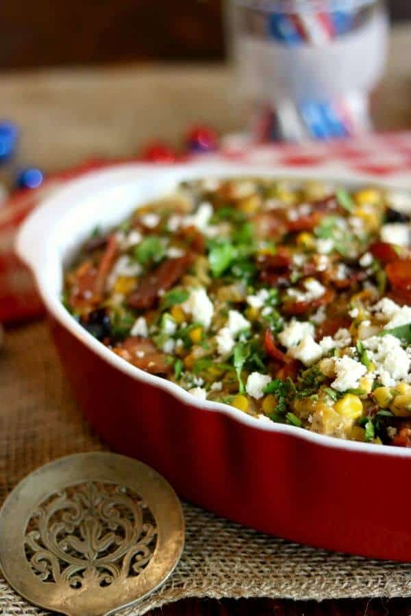 Poblano, cream cheese, smoky bacon... yum! This corn bacon casserole is SO good! From RestlessChipotle.com