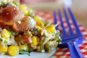 Quick and easy corn bacon casserole recipe makes a great side dish for BBQ and grilled meat. from RestlessChipotle.com