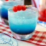 Slushy, refreshing gin and tonic cocktail is red white and blue for summer holidays! From RestlessChipotle.com