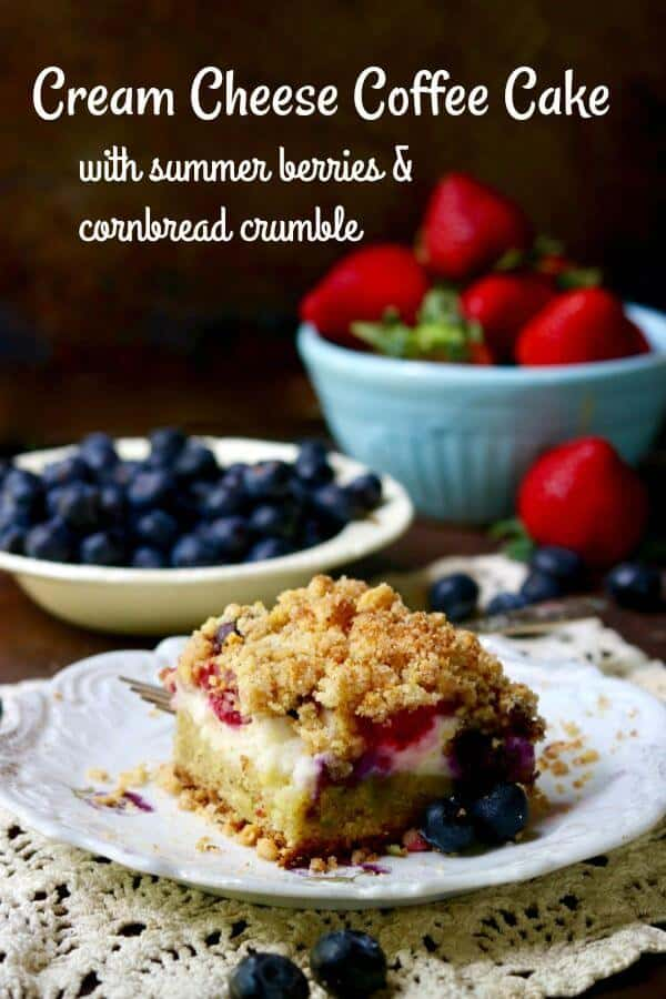 Square of cream cheese coffee cake with raspberries and blueberries in it. Title text overlay.
