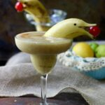 Frozen Banana Daiquiri is slushy sweet with a smooth, creamy texture and a fiery bite. The perfect summer rum cocktail to serve at your next pool party! from RestlessChipotle.com